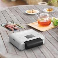 电池供电可随身携带:Canon 佳能 推出新款 SELPHY 便携打印机 CP1200